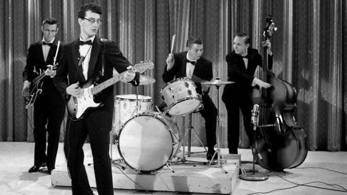 Buddy Holly & The Crickets, establishing the quartet as the foundation of the rock band