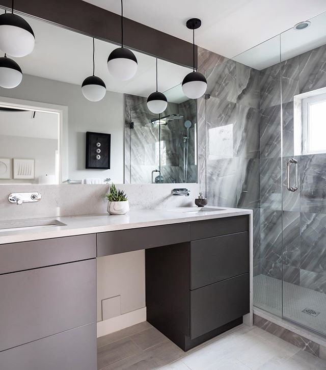 The grey & white master ensuite at our newest duplex build in Vancouver.  Photo: @ishot.ca  Interior Design: @studioten_interiordesign  Interior Styling: @piccolo.design