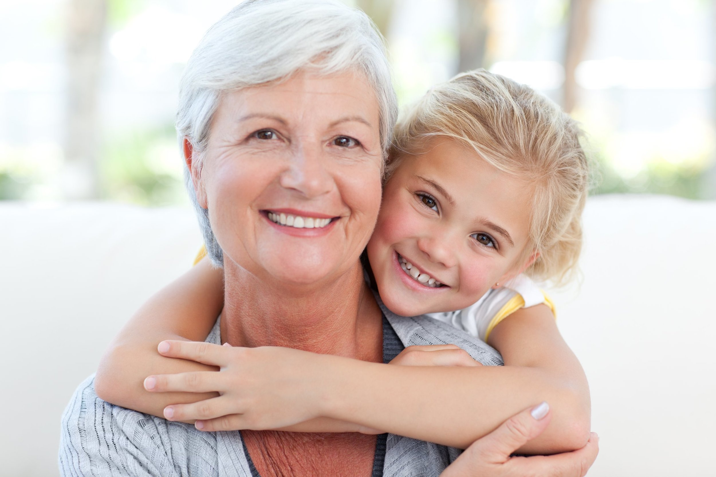 grand mother and grand daughter smiling