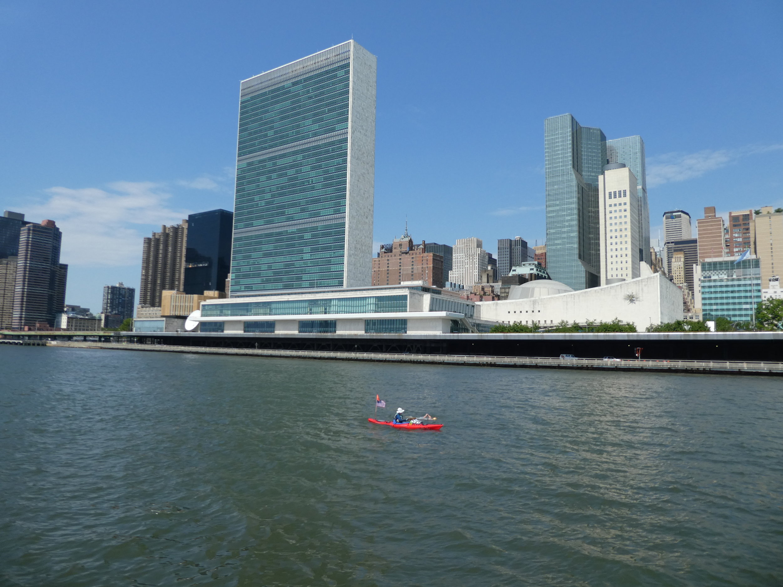 Swimming up the East River, passing the UN Building, summer 2018 Twenty Bridges (7:42:08).