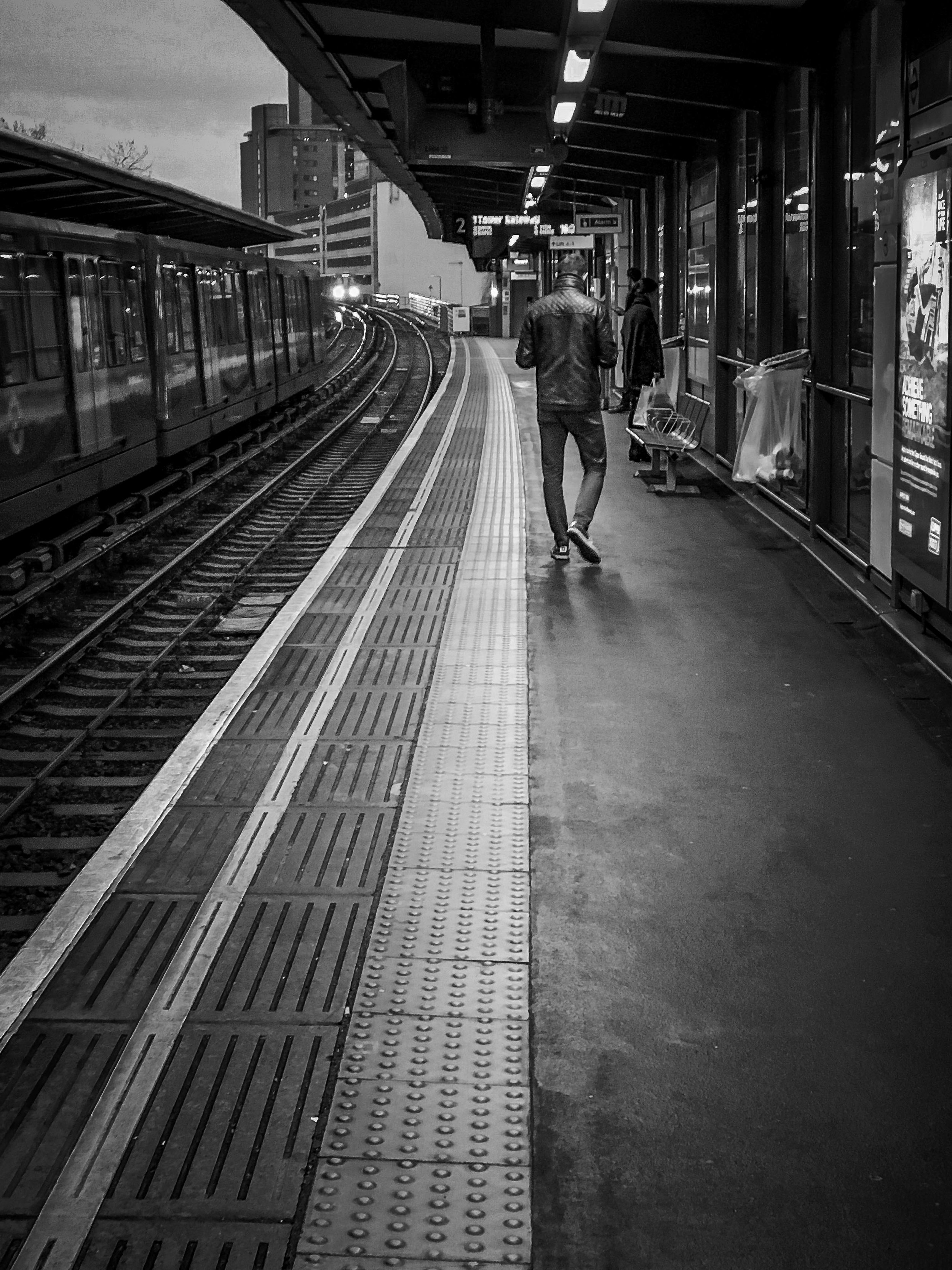 Man on platform in Black and White