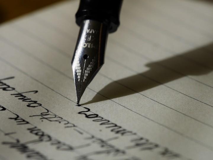 """""""fountain pen on black lined paper"""" by  Aaron Burden on  Unsplash"""