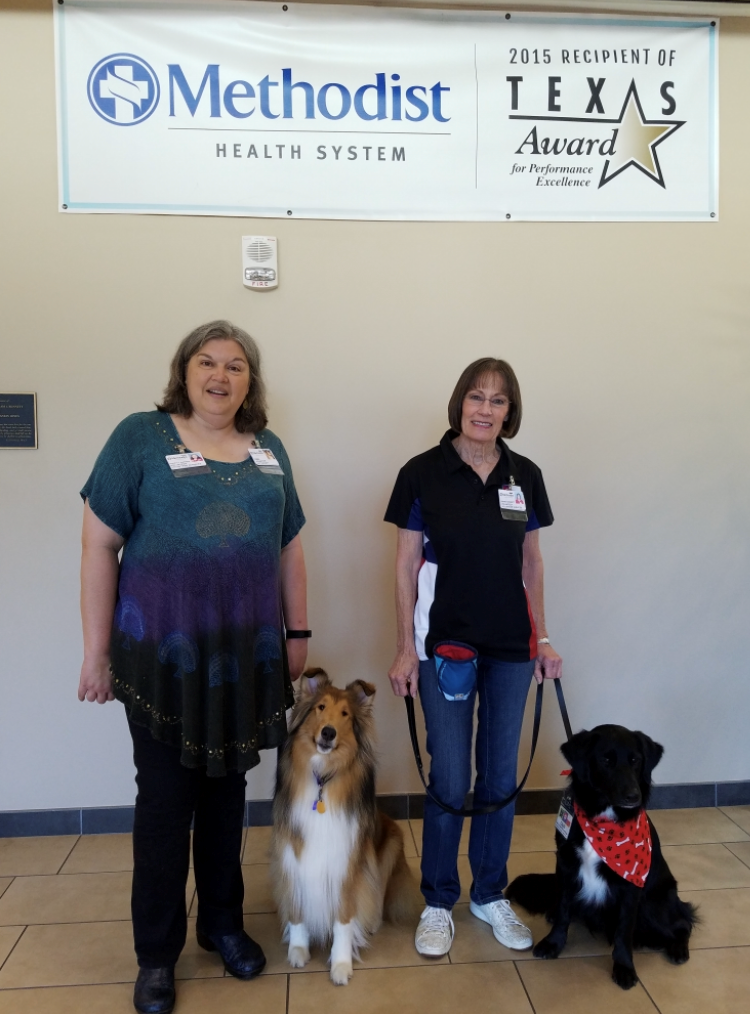 Diane Gossett and her newly registered dog, Caleb, and Sheryll Barker and her latest registered dog, Emma, at Methodist Dallas