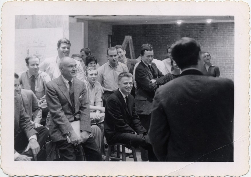 A snapshot of Philip Johnson (with folder in hands), Paul Rudolph (in center, on stool), and Vincent Scully (to the right of Rudolph), at a Yale architecture school jury in 1960. Photo: Stanley Tigerman