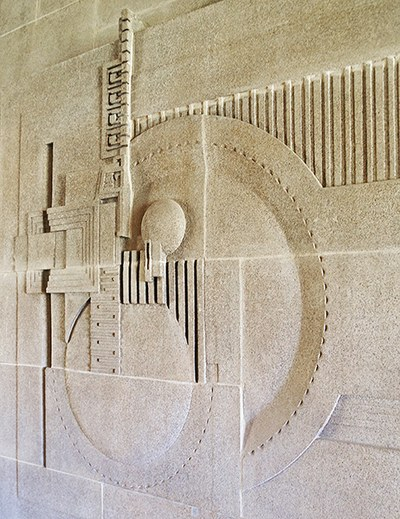 Frieze over the fireplace in the living room of the Wright-designed Hollyhock House, in Los Angeles, California. Image: Architectural Digest