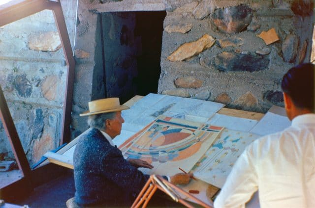 Frank Lloyd Wright (photographed circa the 1950's) looking at a design he'd submitted for Liberty Magazine in the 1920's. Image:  www.franklloydwright.org