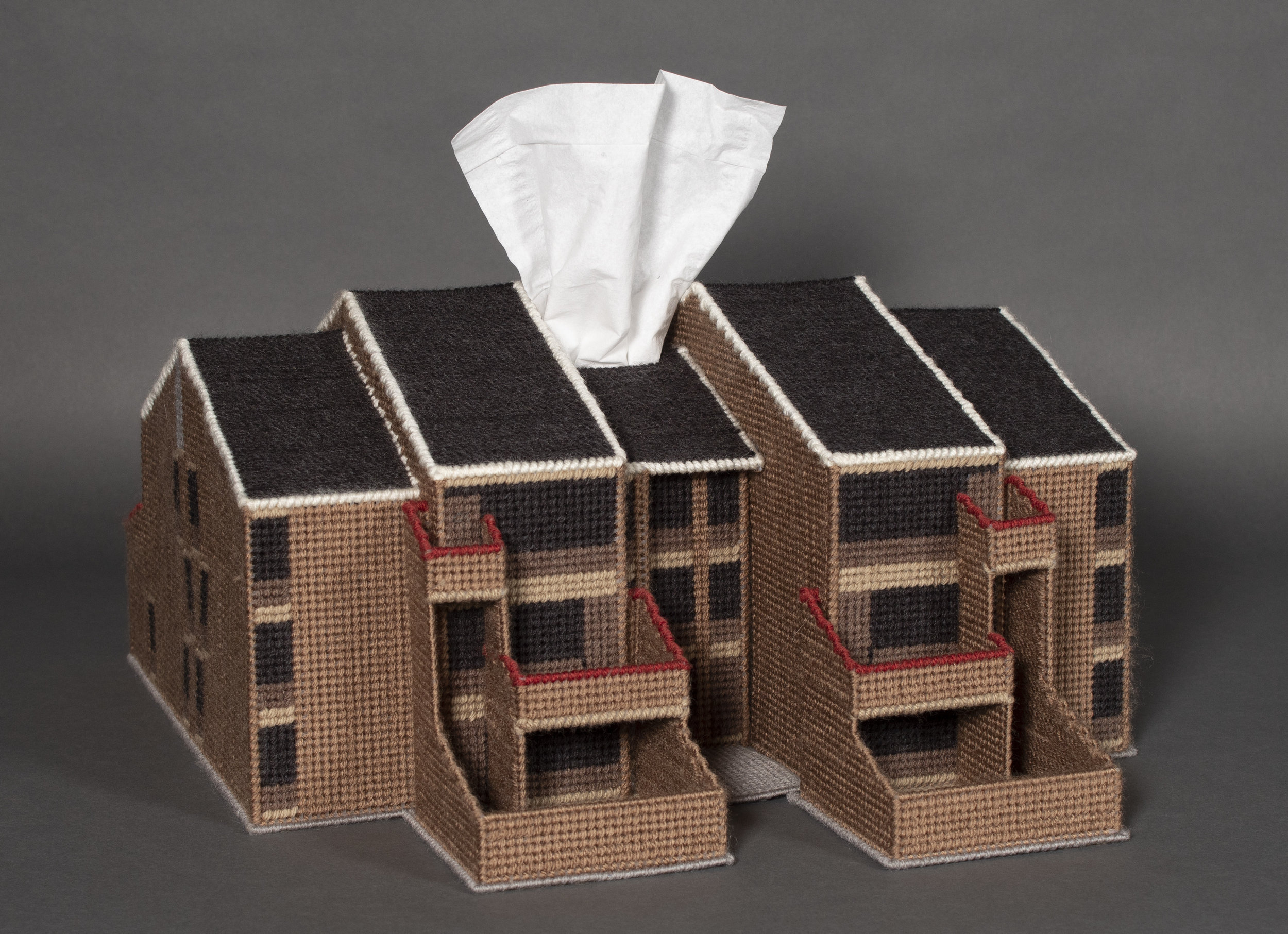 """Disposable: Shoreline Apartment Complex Unit""  Plastic canvas, acrylic yarn, tissue box, 8 X 16.5 X 21 inches, 2016.    An artwork by Buffalo-born & based, fiber artist Kurt Treeby. This is his depiction of Paul Rudolph's    Shoreline Apartments    in Buffalo. It is part of a set of works by Treeby, the ""Disposable"" series, involving—in the artists recounting—""thousands of precise stitches, all sewn by hand…""    Photo:    www.kurttreeby.com"