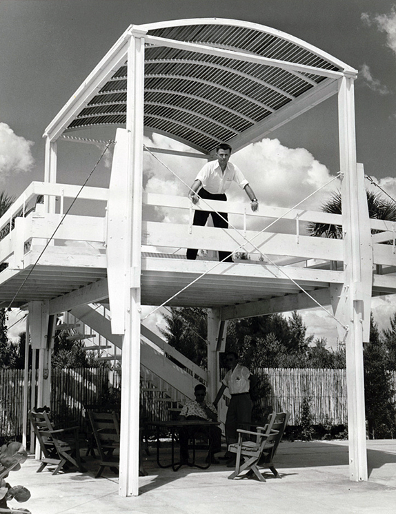 Paul Rudolph in Florida, on the upper deck of the lookout tower of a building he designed: the Sanderling Beach Club, Siesta Key (photo taken circa 1953).    Photo: Library of Congress, Prints and Photographs Division, Paul Rudolph Archive