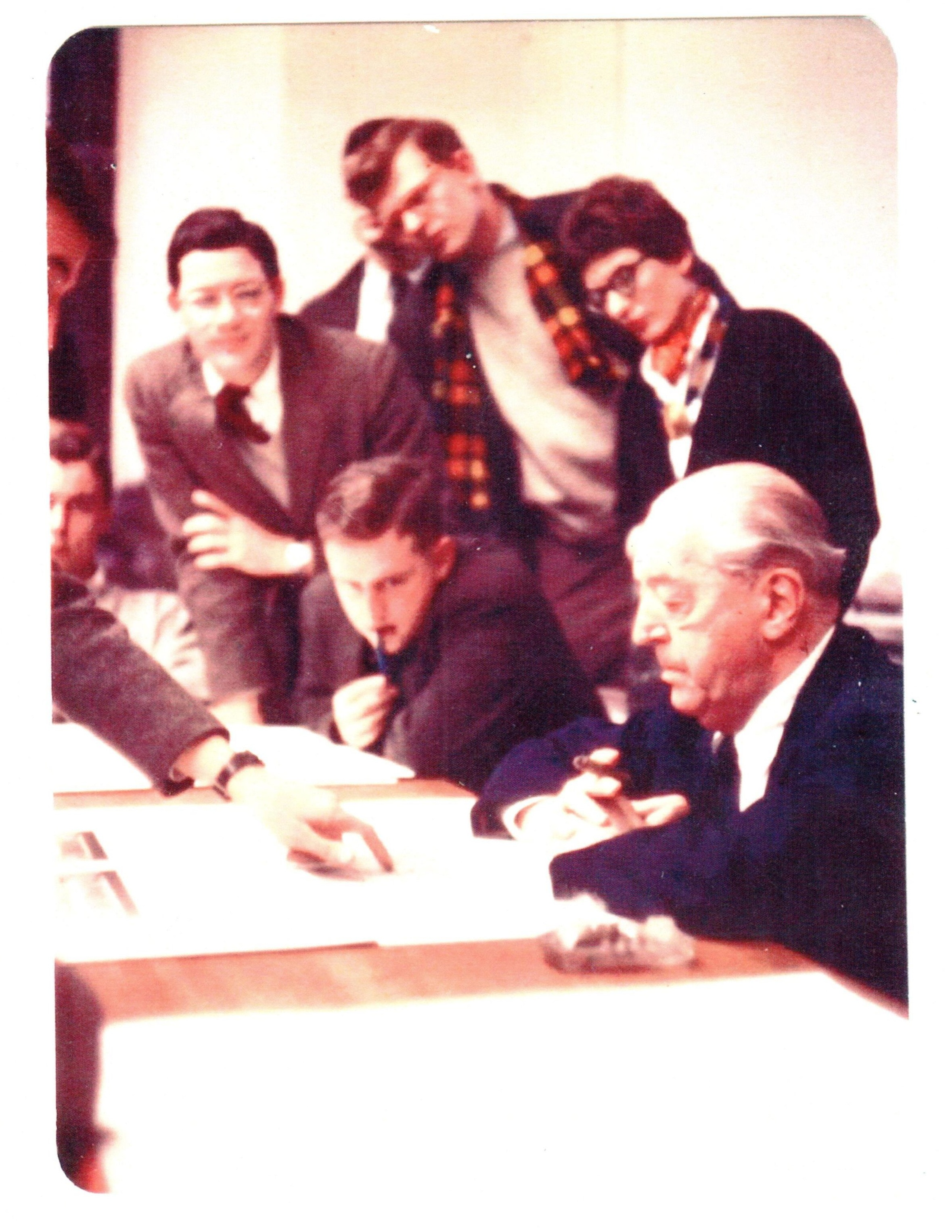 The great architect, Mies van der Rohe (1886-1969), surrounded by students—and, among them, the already distinguished Phyllis Lambert. But what was the occasion and setting?—and whose arm it that, coming from the photo's left edge?     The Canadian Center for Architecture (CCA) did some work on the photo, and the sliver of a face at the upper-left (the owner of that mysterious arm) began to become clearer.    Photo: Paul Rudolph Heritage Foundation archives, with grateful acknowledgment for the photographic enhancement work done by the Canadian Center for Architecture (CCA).