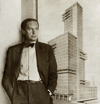 Walter Gropius standing in front of the rendering of his and Adolf Meyer's entry in the 1922    Chicago Tribune tower design competition   —an event which brought forth hundreds of submissions from architects all over the world. The design which Gropius and Meyer offered was formally aligned with what later came to be known as the International Style. Photo courtesy of The Charnel-House. Their in-depth article on the competition—and Gropius' and Meyer's entry in particular—can be found    here   .
