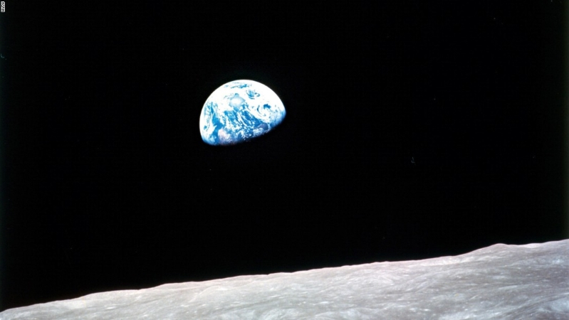 """Earthrise""—probably the most famous photograph to come out of the space program. The photo was taken in 1968 during the Apollo 8 mission—the first time a manned ship had gone to the moon-and-back. Photo by US astronaut William Anders"