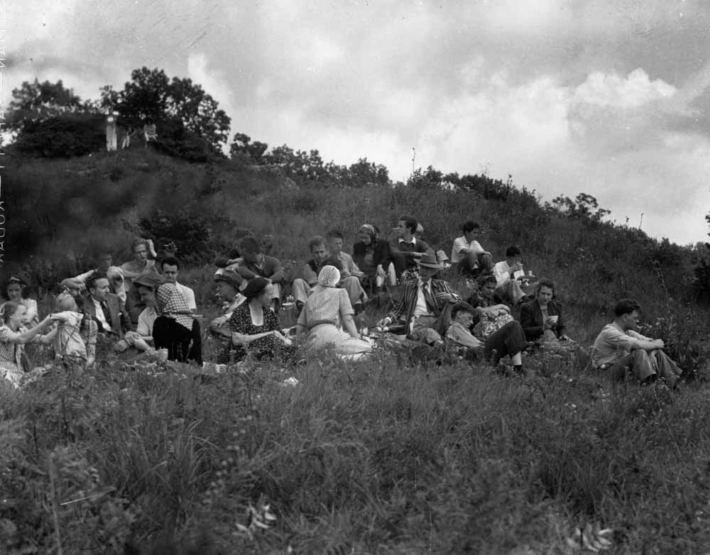 Frank Lloyd Wright and members of his Taliesen Fellowship, out for a countryside picnic. Wright is seated just right-of-center, in the hat and striped jacket. Photo by    Pedro E. Guerrero   , a superb photographer of architecture and the arts (many of whose works    are collected in fascinating books   )—and who is well-known for creating some of the most memorable images of Wright and Wright's community. Photo (c) The Estate of Pedro E. Guerrero