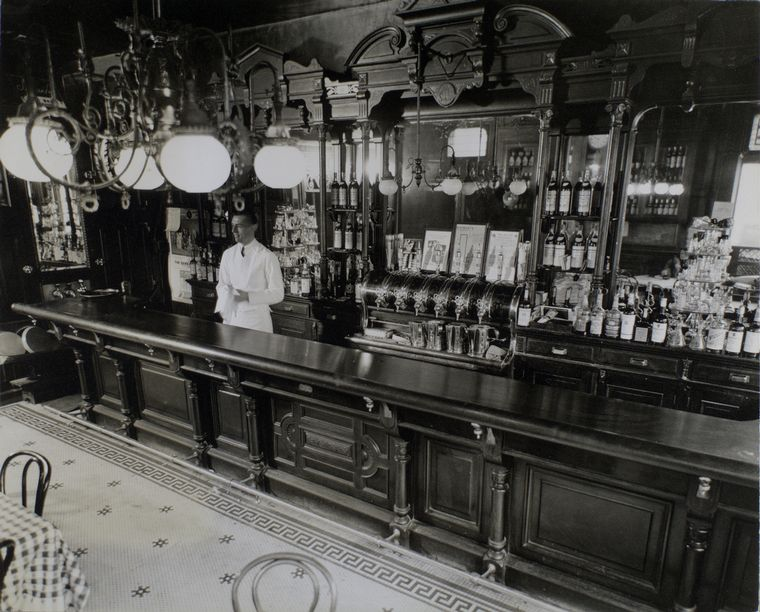 This may be an authentic, archival view of the old bar at Billy's. We don't know what it was like when Rudolph, Johnson, and their friends & colleagues dined there—but in this 1936 photo, it certainly had a most intriguing look. [And if it was like this when our heroes dined there, Johnson might have picked-up some ideas for his Post-Modern phase.] Photograph by: Bernice Abbott, courtesy of the Miriam and Ira D. Wallach Division of Art, Prints and Photographs - Photography Collection, The New York Public Library