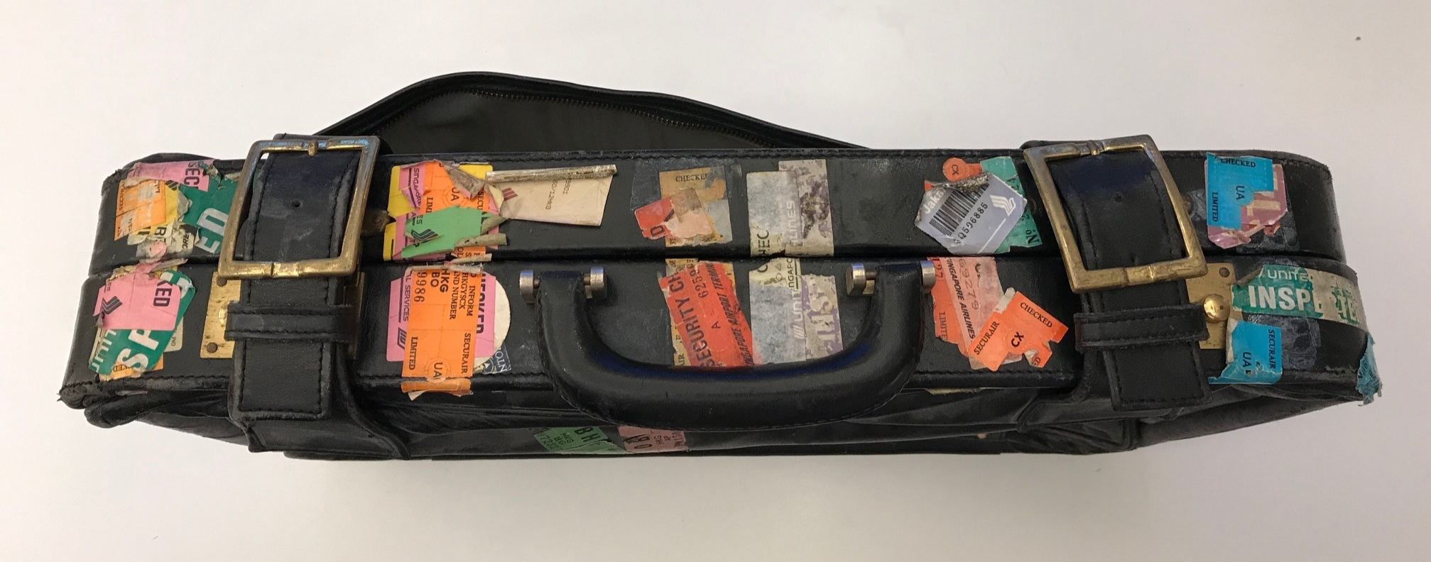 An example of Paul Rudolph's luggage. The layers of airport inspection stickers testify to his endless travel. From the collection of Ernst Wagner.