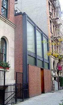 What secrets lie beyond that door? The front facade of Philip Johnson's home, at 242 East 52nd Street in Manhattan. Originally designed by Johnson—in his most Miesian phase—as a guest house for the Rockefeller family, it was later donated by them to the Museum of Modern Art (for the same use).    It is now a NYC landmark   . Among the later residents was Johnson himself, who made it his NYC home in the 1970's. Photograph courtesy of   galinsky.com