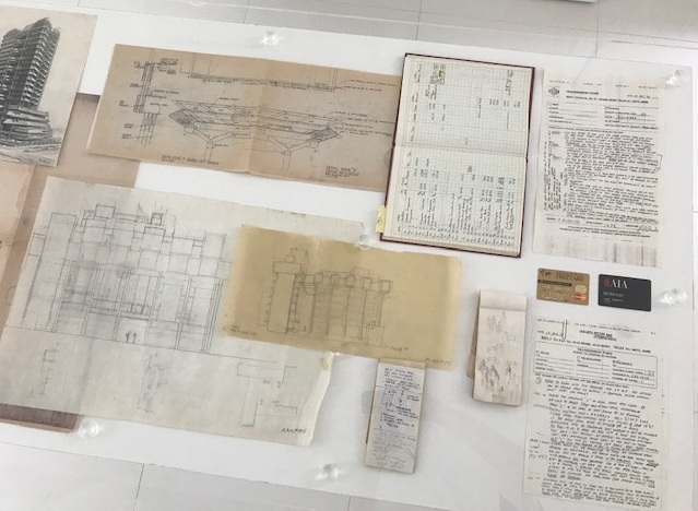 Some Rudolph-ian items, recently on display at the Paul Rudolph Heritage Foundation. At the top-center is a print of a drawing by Paul Rudolph, showing his intentions for the structure and detail of a portion of the Deane Residence (built in Great Neck, NY). That drawing, as well as the Rudolph's drawings for the Yale Art & Architecture Building (that are also shown here) were generously donated by R.D. Chin. Other items in this view (on the far right) are two faxes which Rudolph sent from Jakarta to the staff of his New York office (while he was traveling overseas to work with clients). In those faxes, he'd address various staff members, giving each instructions about the various projects they were working on.—and occasionally theses faxes would include small architectural diagrams. [It is worth noting that these were sent when faxing was the high-tech communications technology of its time: before e-mail, faxing was the fastest and most efficient way that businesses could use to send written and graphic information.]