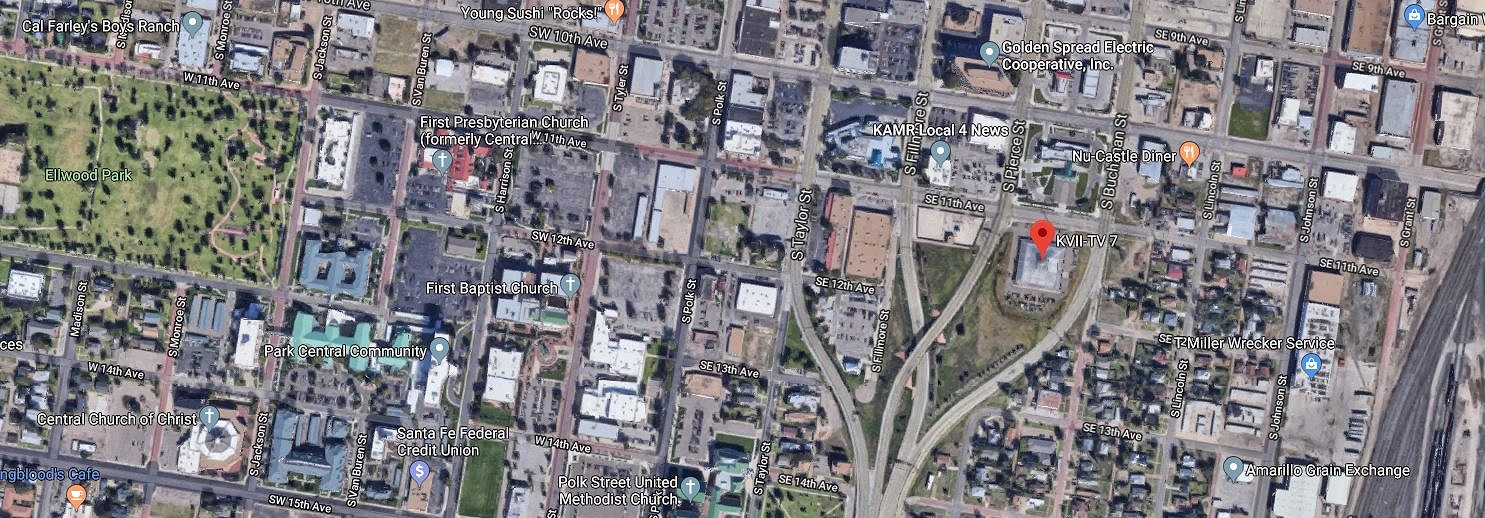 The context for the building:    A satellite view of the neighborhood where the pyramidal TV station is located in Amarillo, Texas. North is towards the top, and the building's roof is marked by the red arrow. Amarillo's Elwood Park is at the far left, and railroad lines are at the right edge of the photo. The several forking roads, which merge towards at the bottom of the picture, converge to form US Highway 287. Image courtesy of Google: Imagery ©2019 Google, Imagery ©2019 Maxar Technologies.
