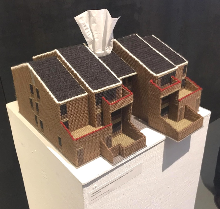 Included in the exhibit were examples of Kurt Treeby's artwork. Here he bases one on a portion of a row of Shoreline's Rudolph-designed townhouse. The tissue-boxification is Treeby's commentary our our society's throwaway attitude to our architectural heritage. For more on Treeby's work—and to see further examples of his work in this mode—     see our blog post about him.      [Photo by Barbara Campagna]