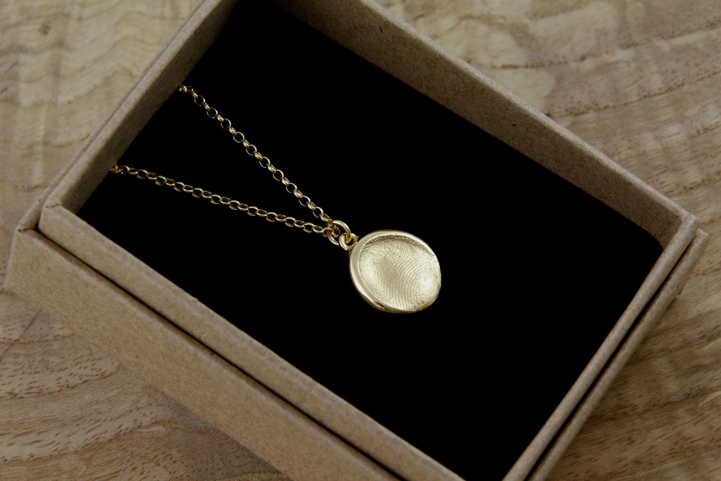 gold fingerprint pendant.jpg