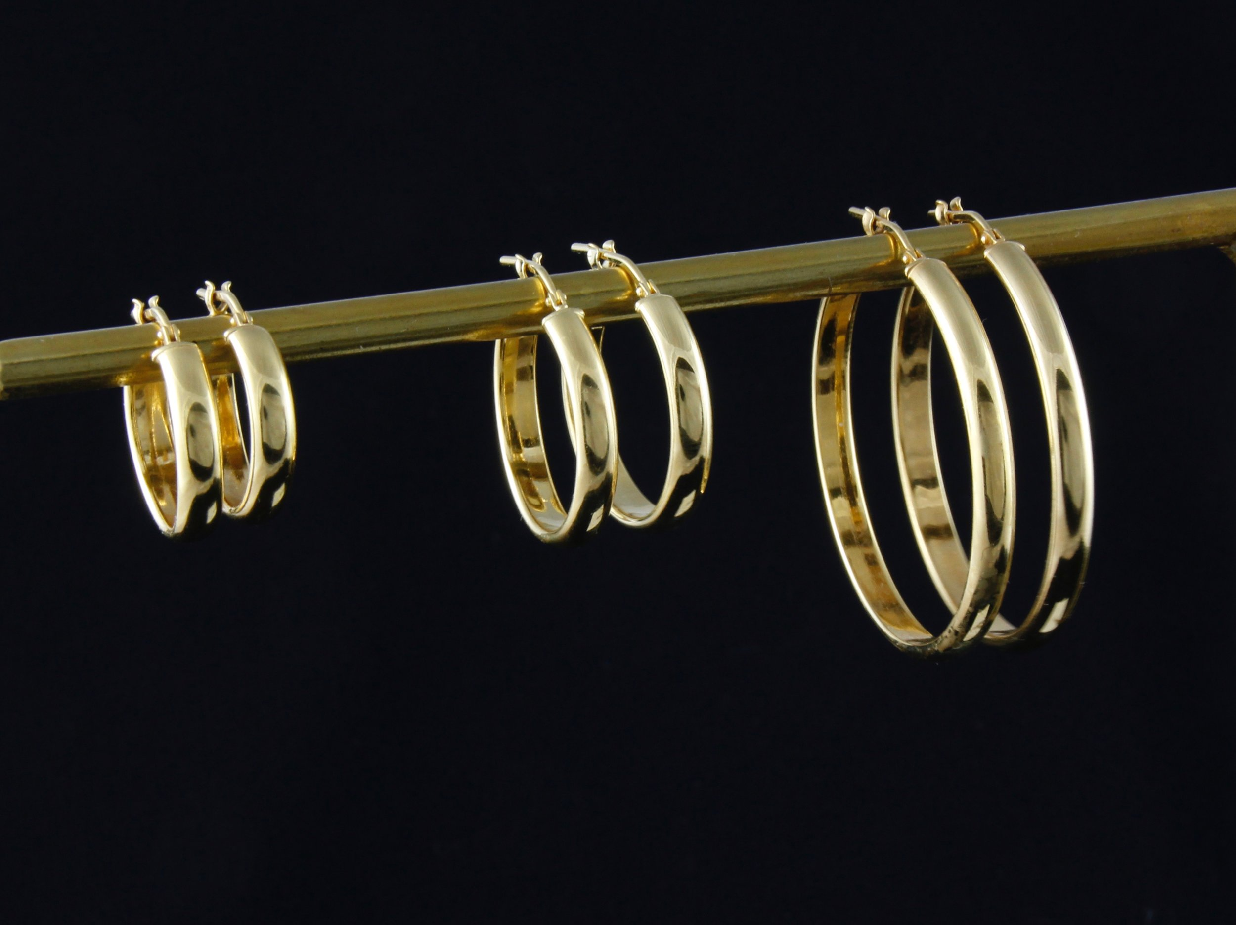 Gold peggy hoops Trio.jpg
