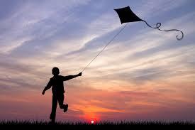 backlit-child-with-kite.jpg