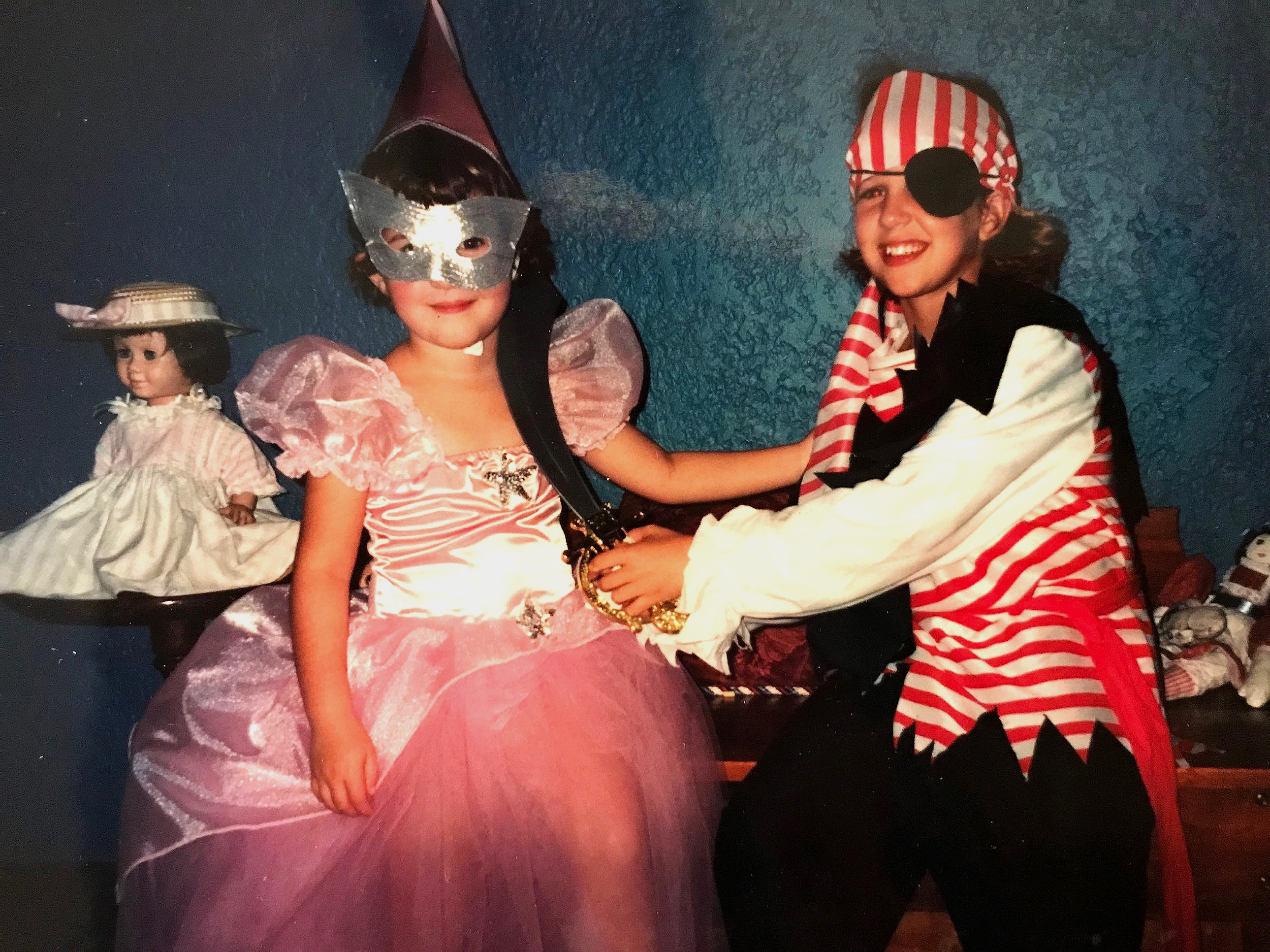 Meg (left) as a fairy princess. MK (right) as a pirate killing a fairy princess.