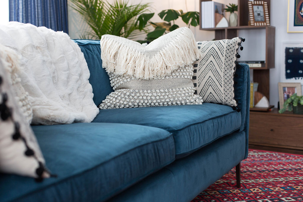 Blue couch with boho pillows