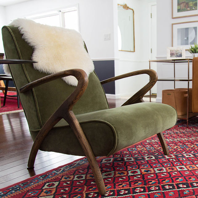 Olive green velvet chair in bohemian living room