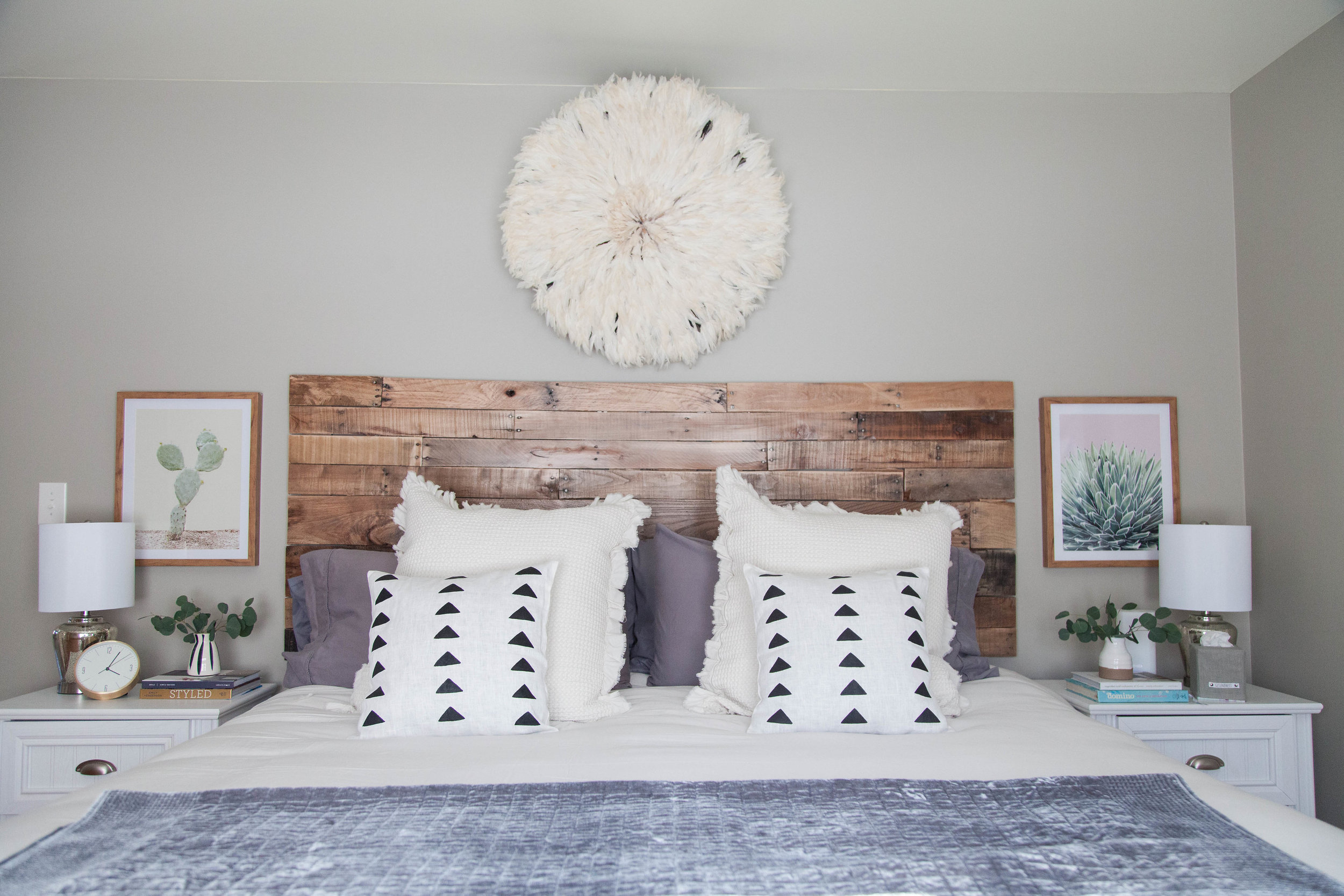 Guest bedroom with handmade wood headboard and mixed metals on nightstands in Hamilton, NY