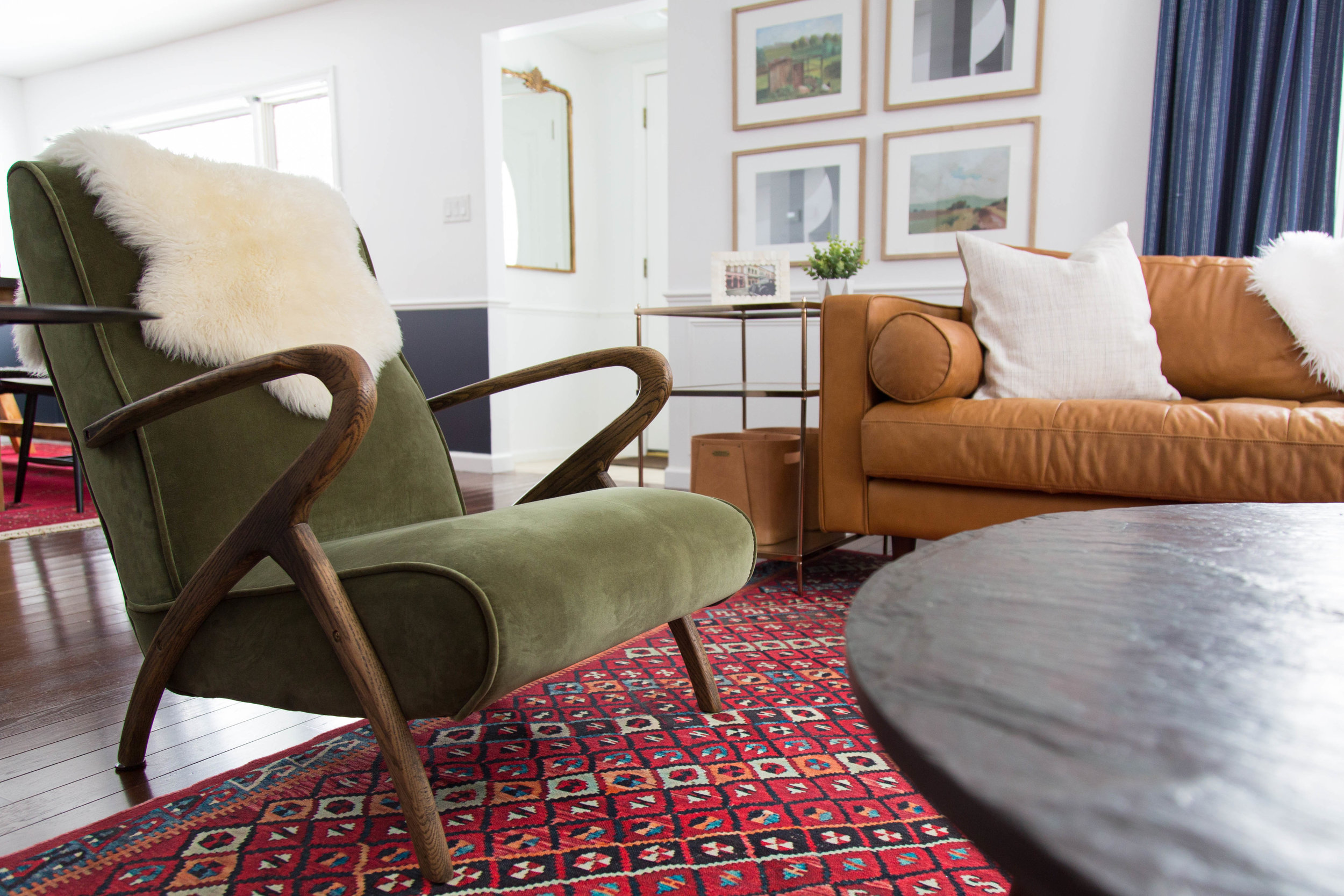 Green chair and camel leather couch in living room, Georgetown, NY