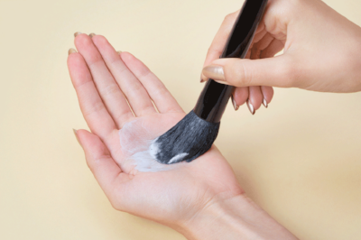 Flip the brush downward and rub the brush in the palm of your hand, using a circular motion.