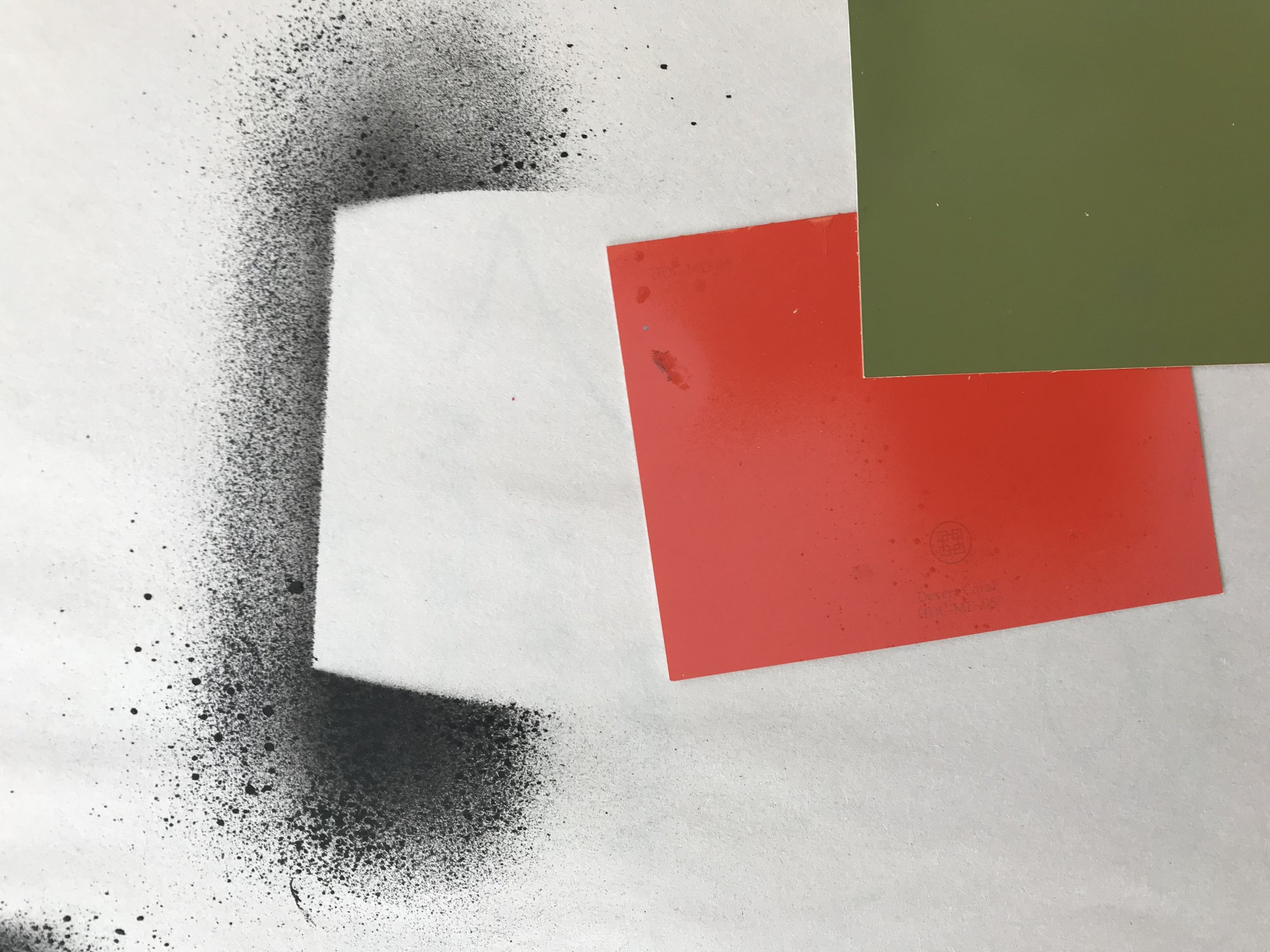 Pictured above are paint swatches used to create negative space. I began asking bigger questions such as: how can negative space show positive brand aesthetics?