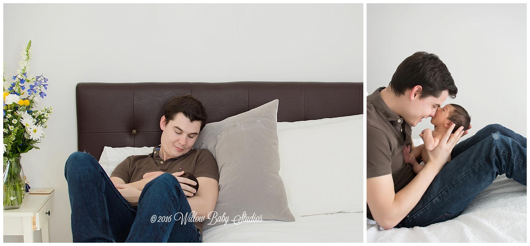 dad-holding-admiring-his-newborn-son