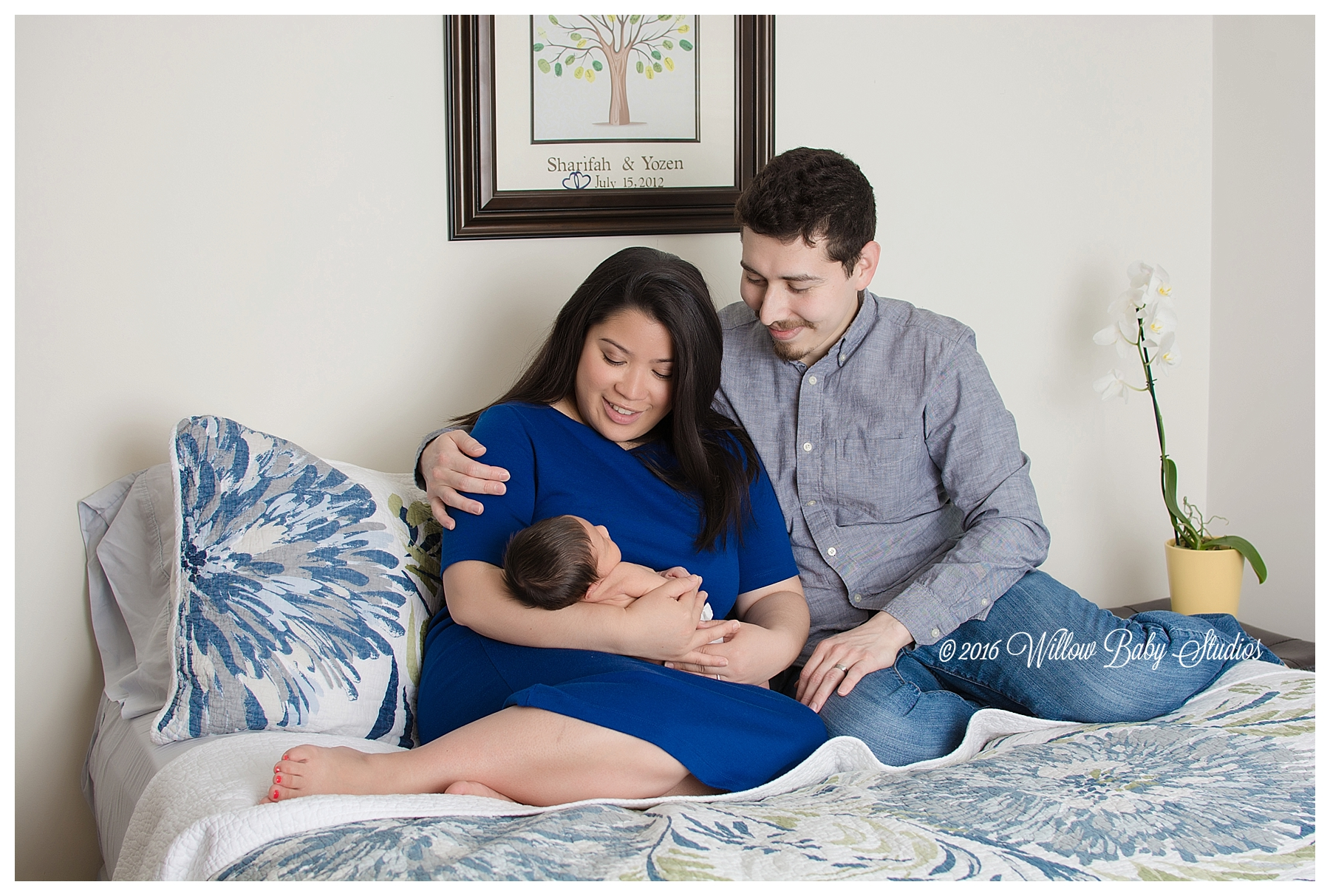 new-parents-snuggling-boston-baby