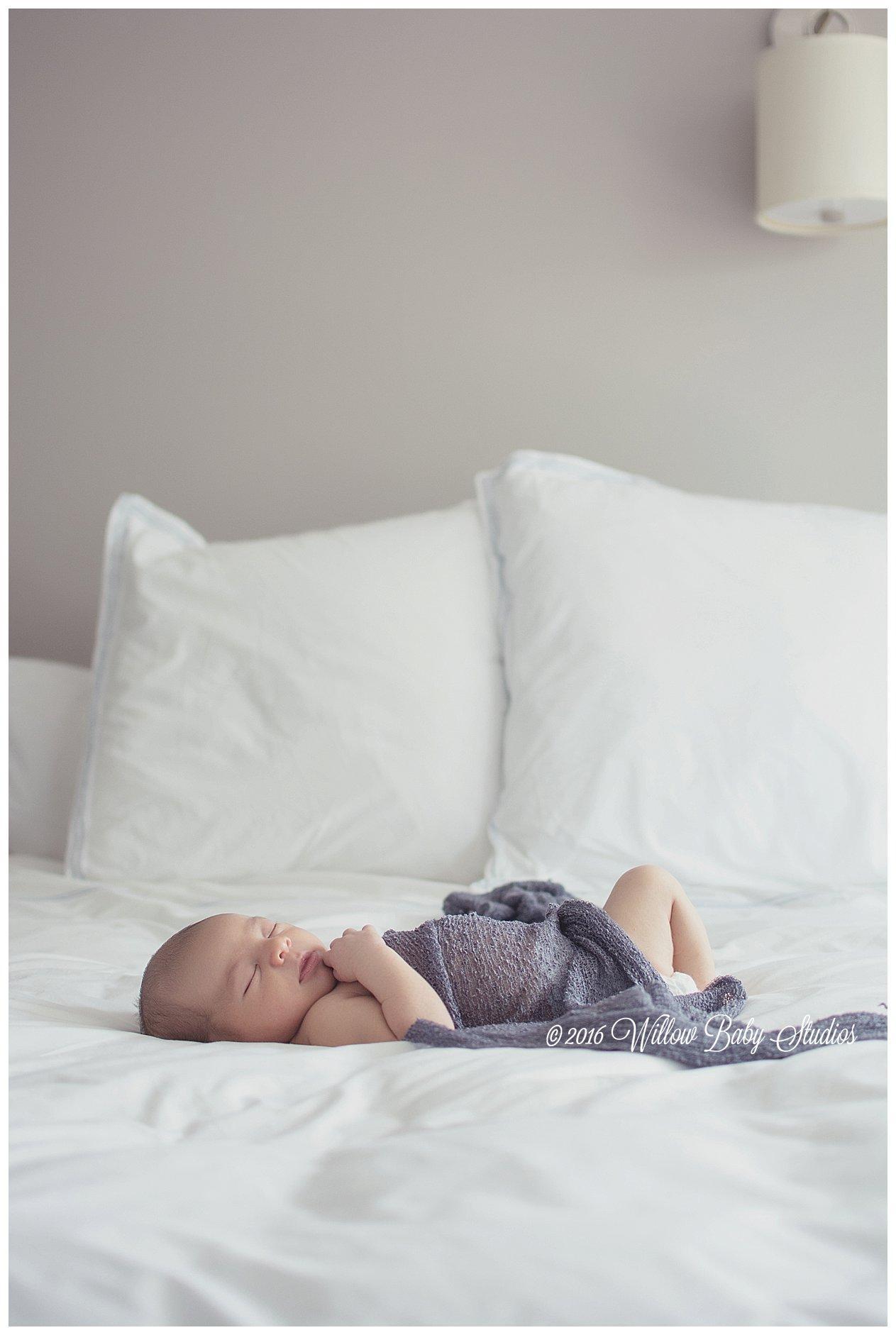 newborn-sleeping-alone-on-parent's-bed