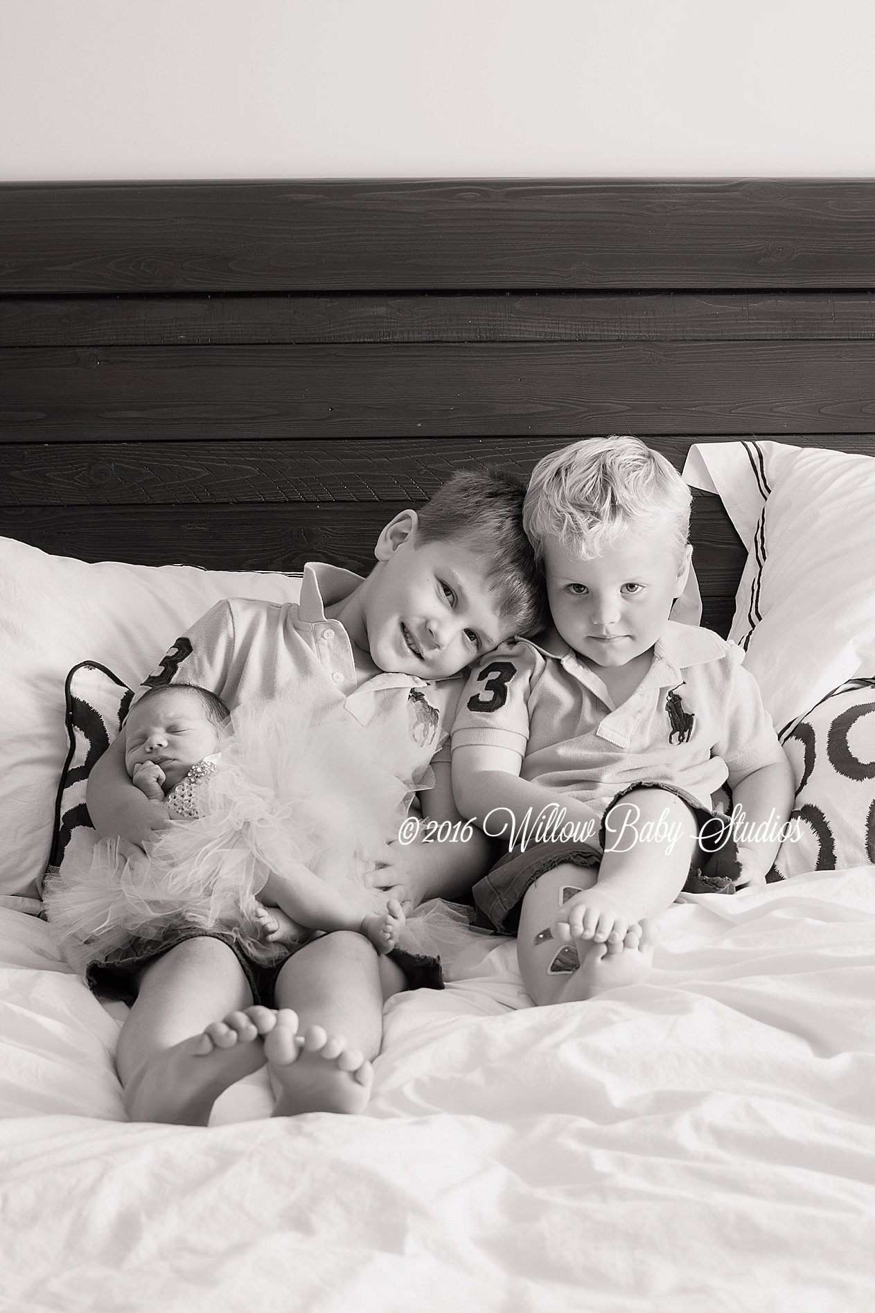 two big brothers with newborn sister