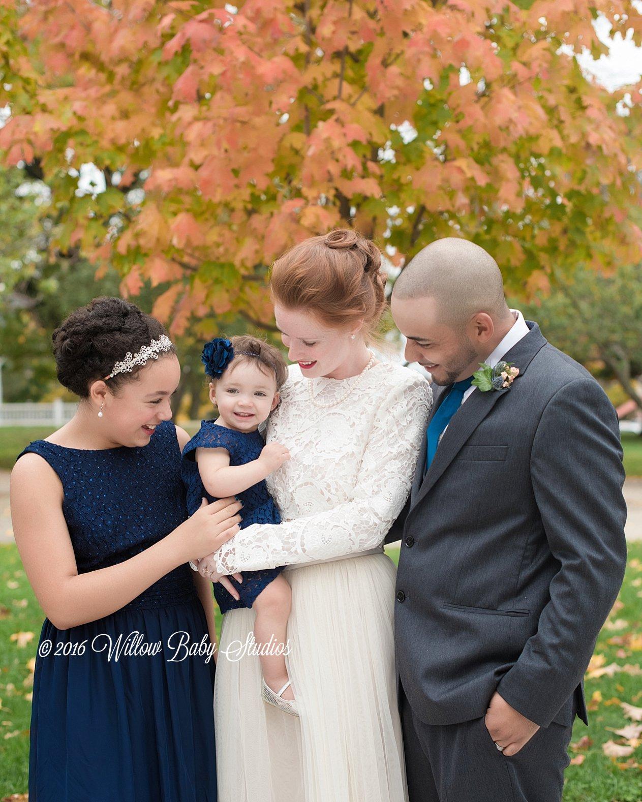 family of four celebrating their fall wedding