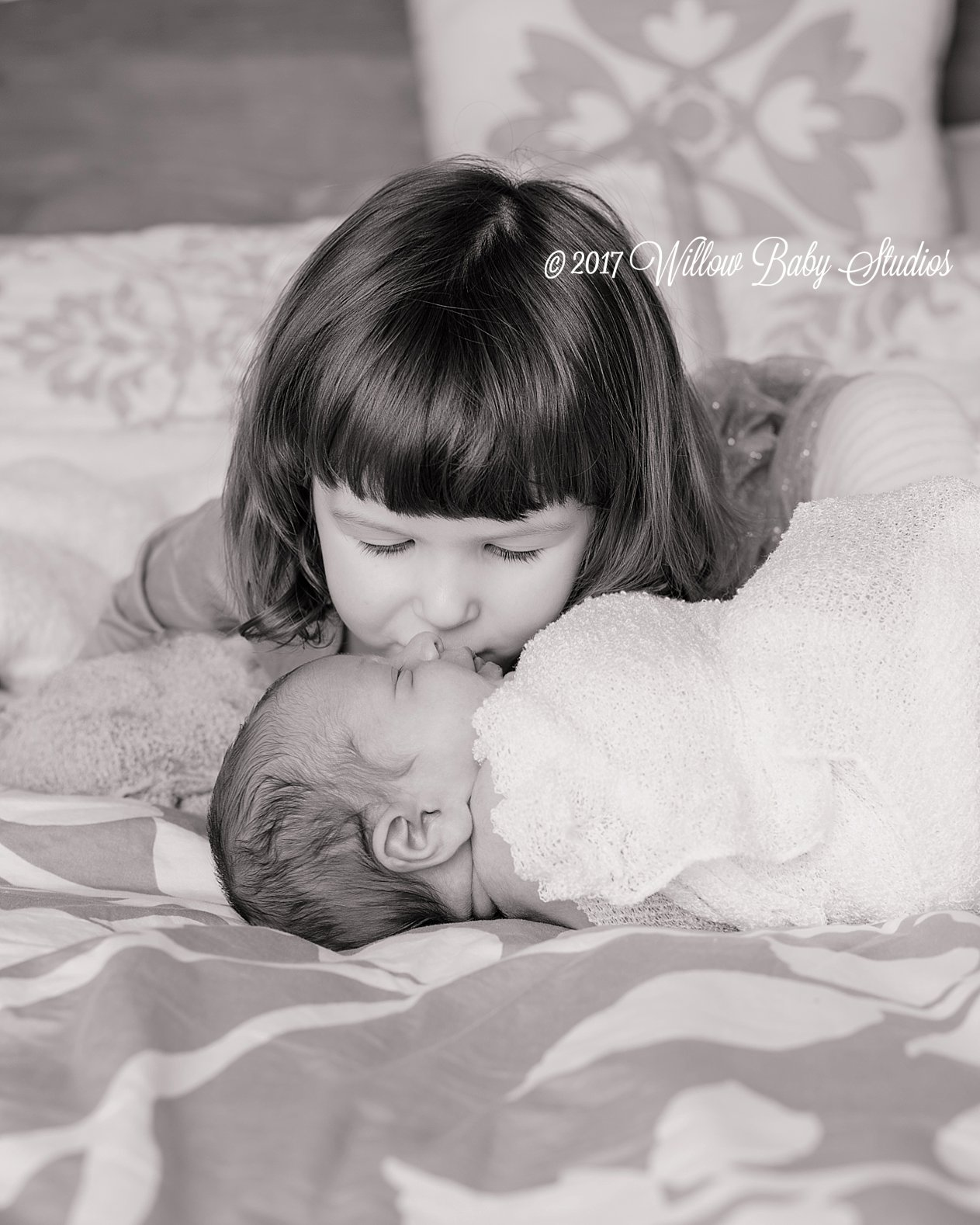 toddler-kissing-her-brand-new-brother