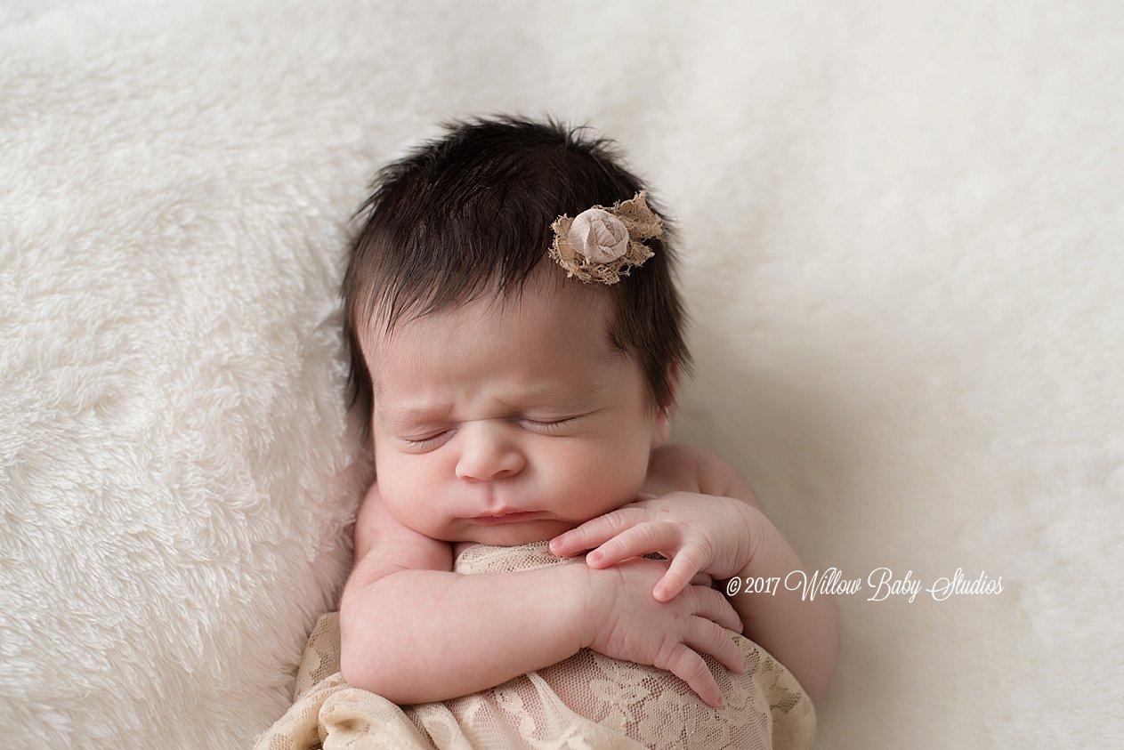 sleeping-newborn-girl-vintage-headband-lace-wrap