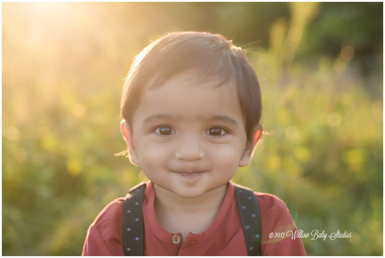 one year old with super cute smile at golden hour