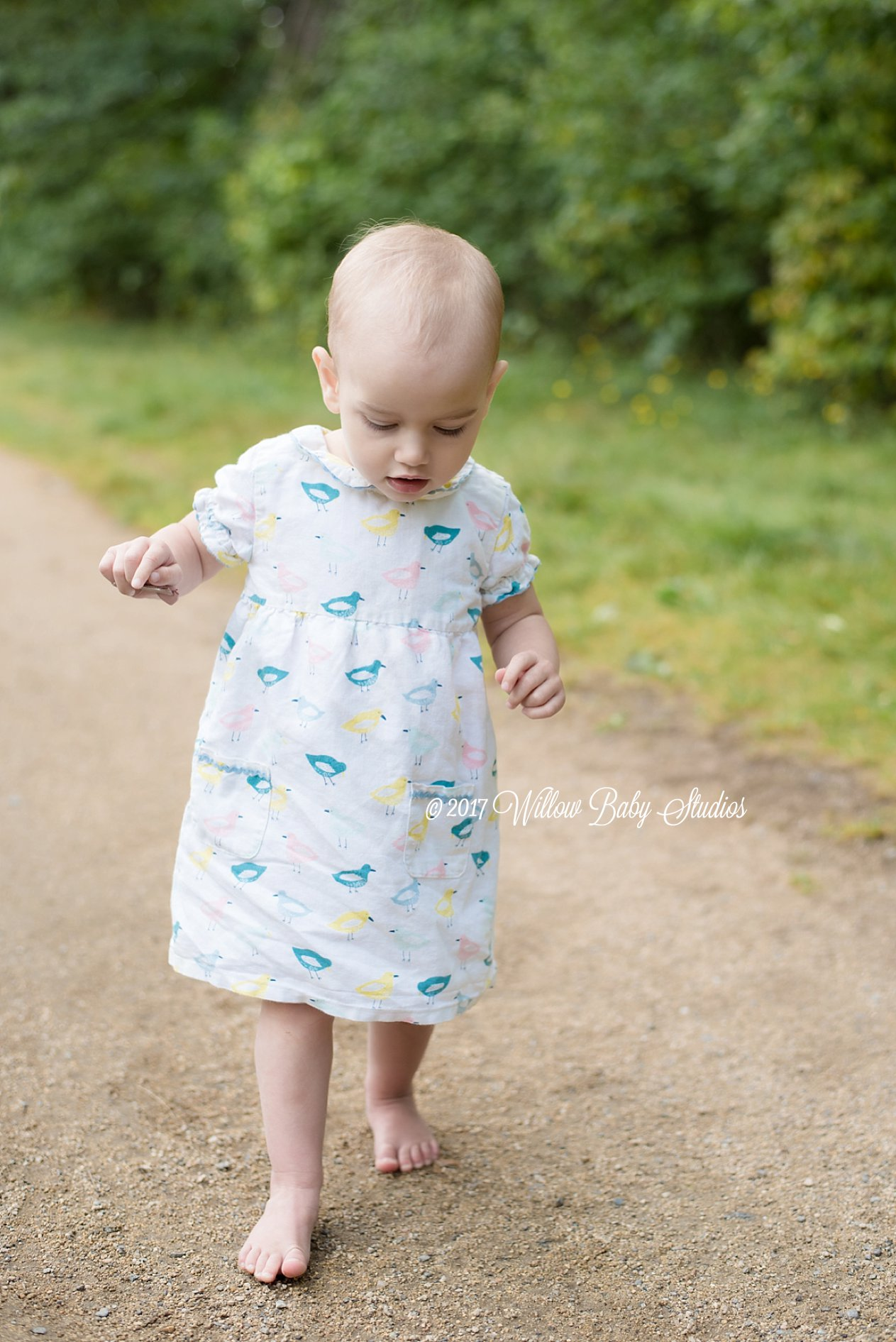 toddler walking on a dirt path