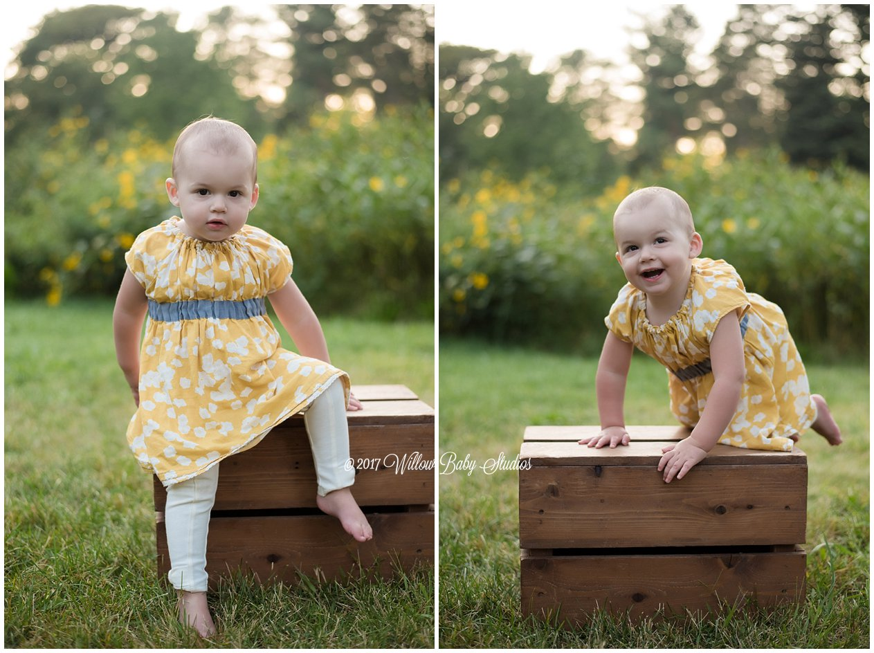 toddler at sunset playing on a wooden box