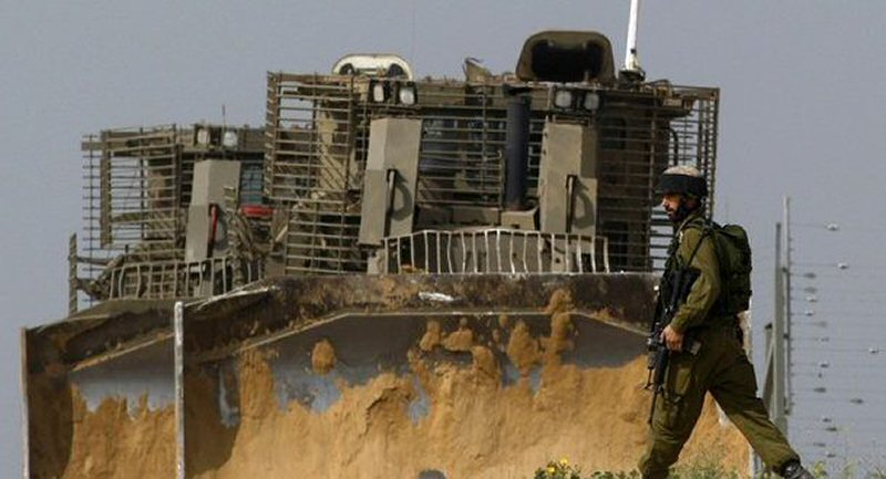 Weaponized bulldozers and soldiers inside Gaza borders