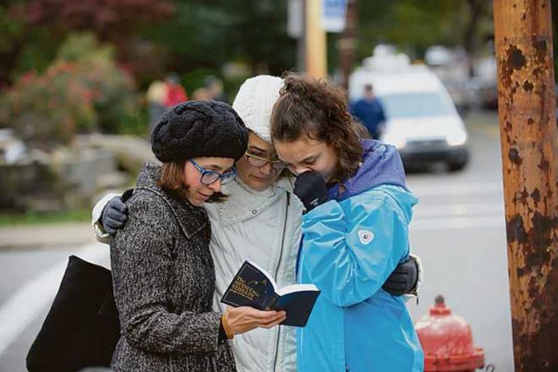 Finding comfort in prayer. AFP