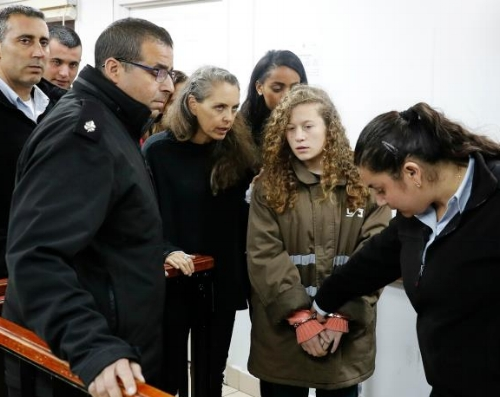 Ahed Tamimi enters court in handcuffs.
