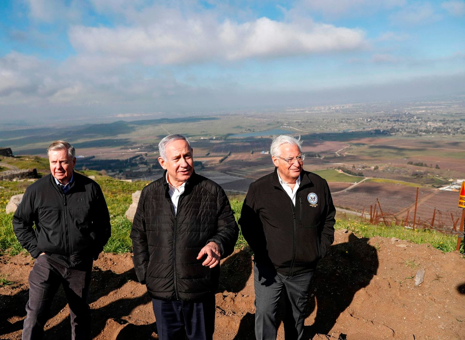 From left, Sen. Lindsey O. Graham (R-S.C.), Israeli Prime Minister Benjamin Netanyahu and the U.S. ambassador to Israel, David Friedman, visit the border between Syria and the Israeli-occupied Golan Heights earlier this month. (Pool photo by Ronen Zvulun/AFP/Getty Images)