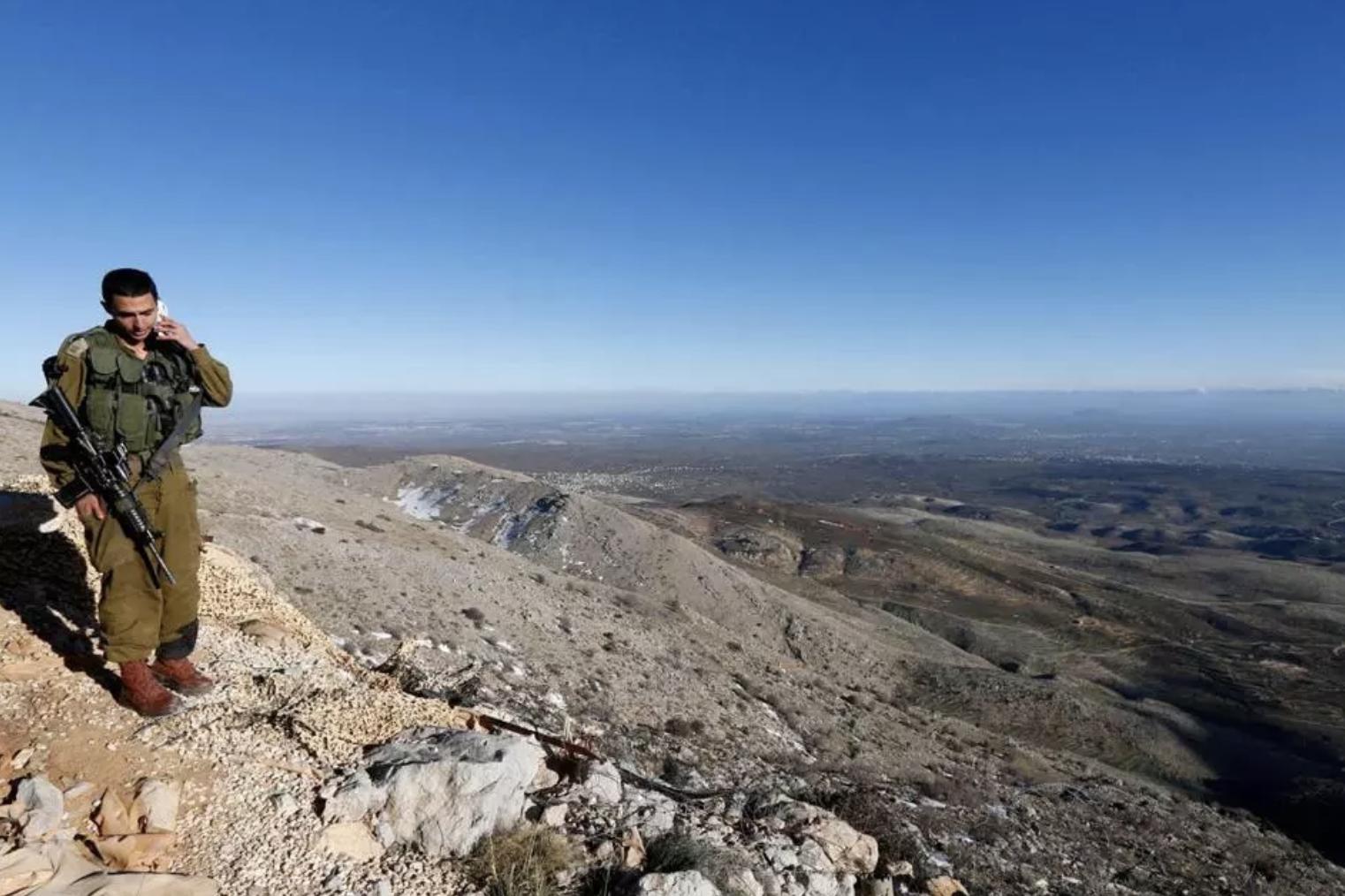 Israeli soldier overlooks the Golan Heights