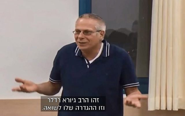 Rabbi Giora Redler, a teacher at the the pre-military academy in the West Bank settlement in Eli. (screen capture: Channel 13)