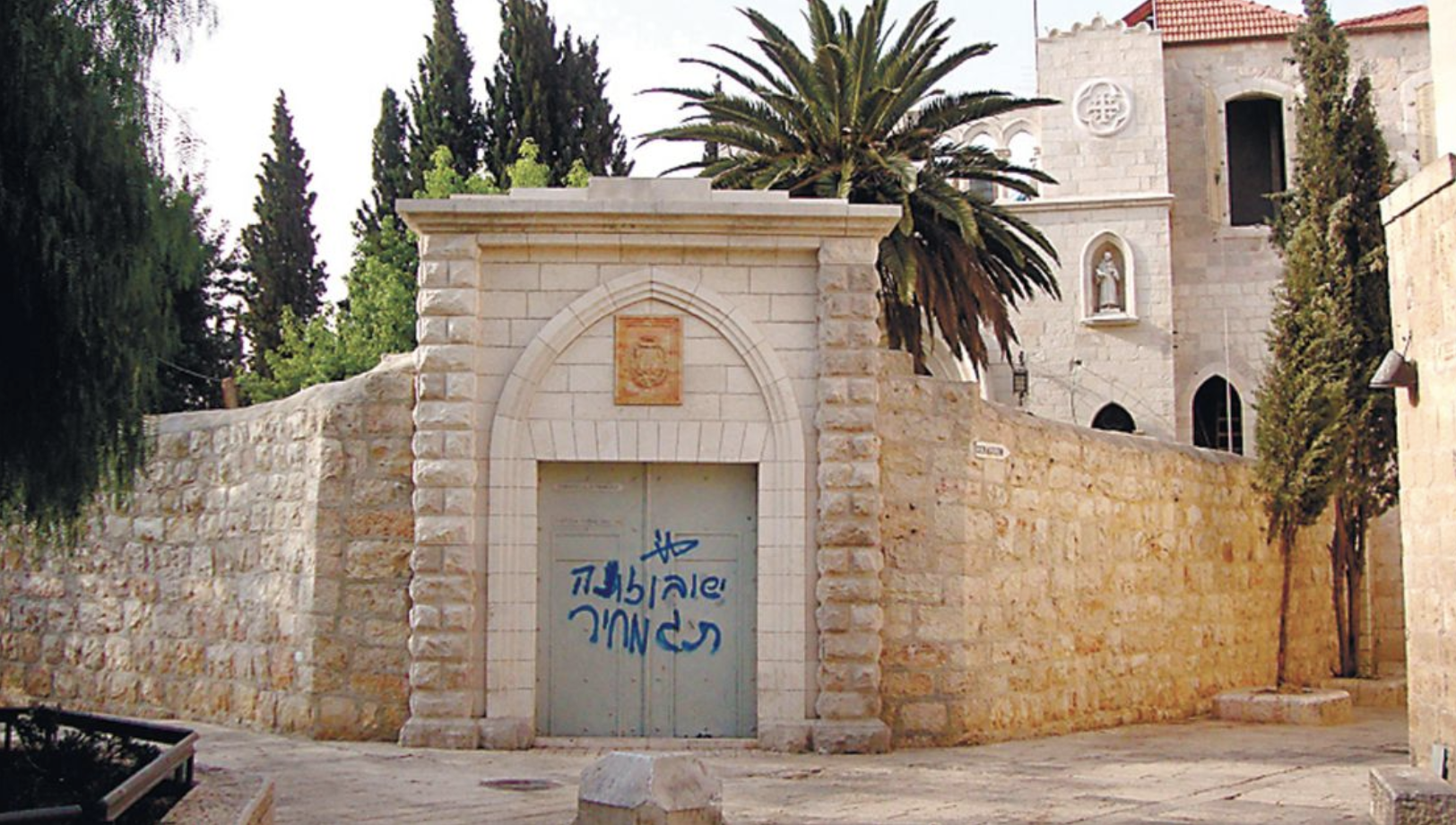 Graffiti reading 'Jesus, son of a bitch, price tag,' was found on a door near the Franciscan monastery on Mount Zion, just outside the walls of Jerusalem's Old City. Credit: AP/HO