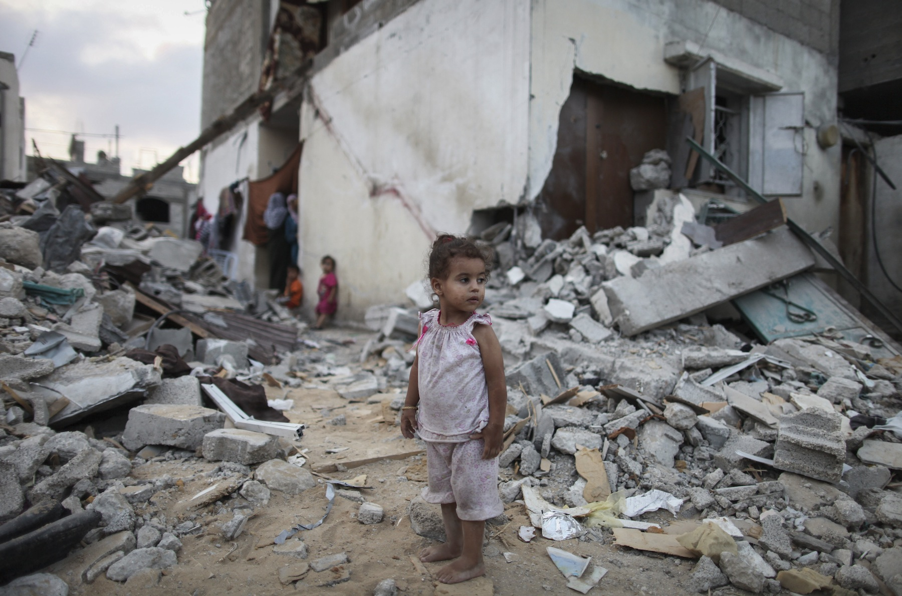 A Palestinian child amid the rubble of homes destroyed by Israeli airstrikes in the northern Gaza Strip, Aug. 18, 2014. (Emad Nasser/Flash90